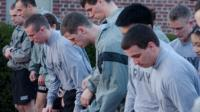 Group of cadets getting ready to run on a track. Physical Training (PT)