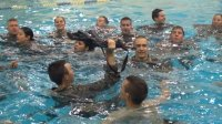 combat water survival training, group in pool
