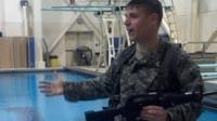 Cadet standing next to pool, demonstrating combat water survival maneuvers